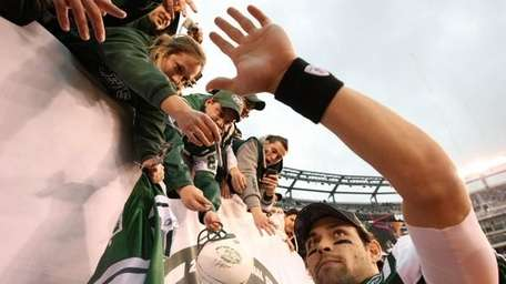 Mark Sanchez high-fives fans after the Jets' final
