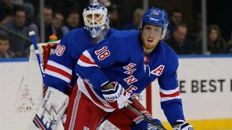 Rangers defenseman Marc Staal watches the play in