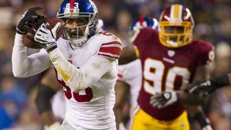 Giants wide receiver Michael Clayton is chased by