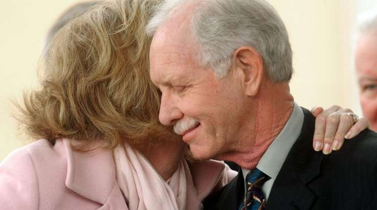"Chesley ""Sully"" Sullenberger gets a hug from his"