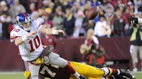 New York Giants' Eli Manning throws the ball