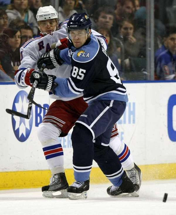 Rangers' Marian Gaborik, left, is checked by Florida