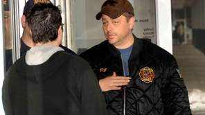Mastic fire department chief Dwight Blankenship talks to