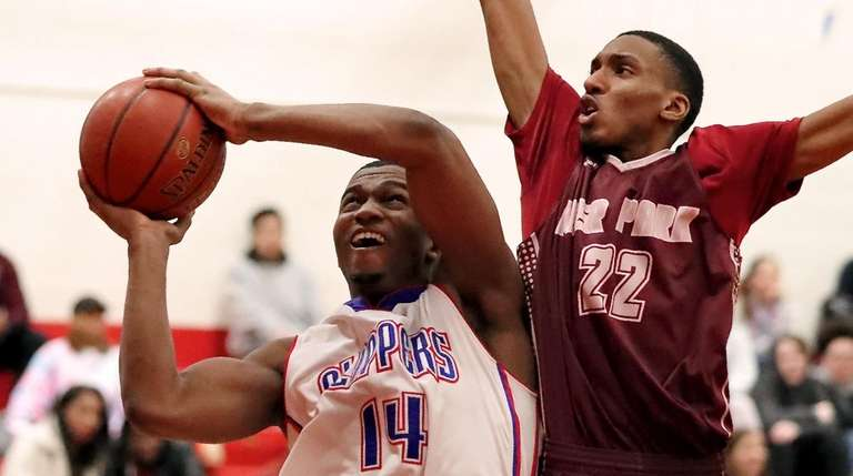 Bellport's Jarell White battles to put up a