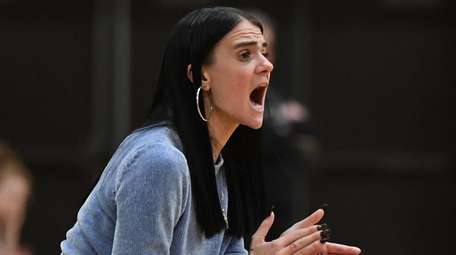 Ward Melville head coach Samantha Prahalis reacts during