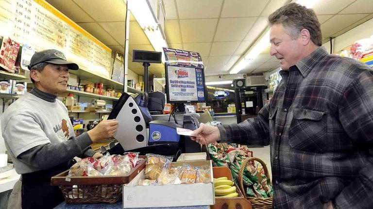 Store owner Hong Lee sells Frank Riola a