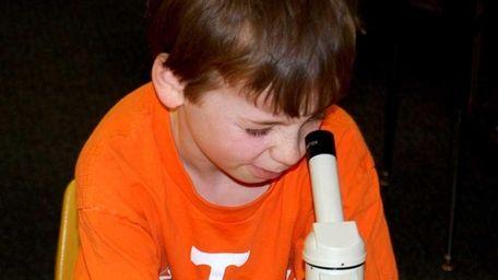 Benjamin Hayden, third grade from Northport, looks into