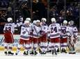 The New York Rangers celebrate after defeating the