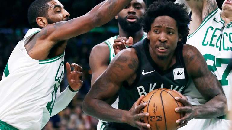 Brooklyn Nets forward Ed Davis is pressured by