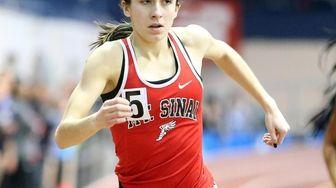 Kayleigh Robinson of Mt. Sinai crosses the finish