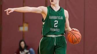 Pat Williamson #2 of Harborfields directs his offense