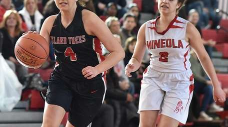 Brianna Fitzgerald #4 of Island Trees, left, races