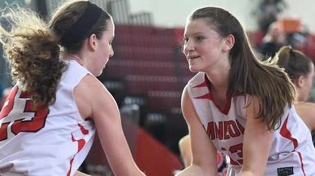 Meaghan McCaffrey #13 of Mineola, right, congratulates teammate