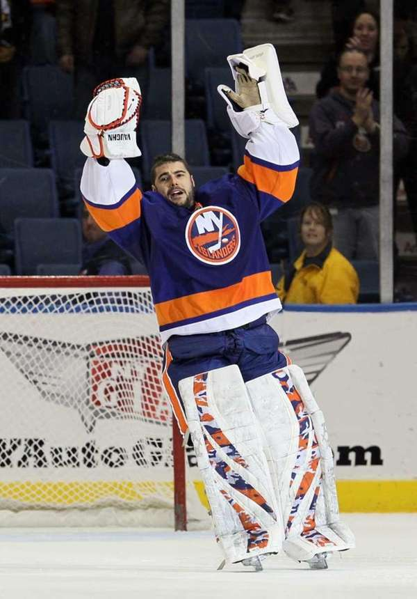 Islanders goalie Rick DiPietro celebrates after defeating the