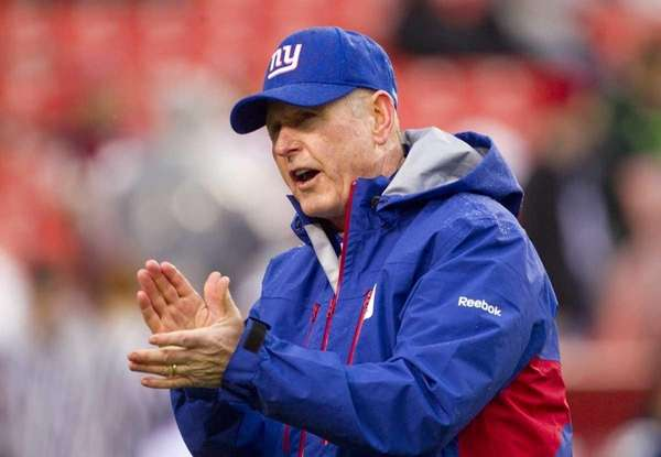 Giants head coach Tom Coughlin cheers on his