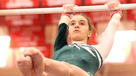Carle Place's Joanna Signorile competes on the uneven
