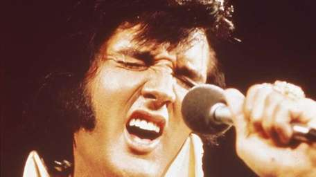 Elvis Presley performing live onstage at the