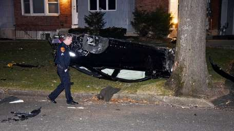A Suffolk County police officer examines the scene