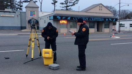 Suffolk County police investigate the scene on Route