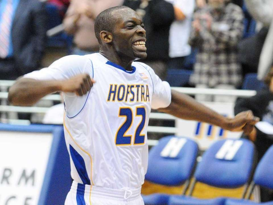 Hofstra University guard #22 Charles Jenkins reacts after