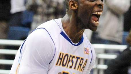 Hofstra University guard Charles Jenkins reacts after his