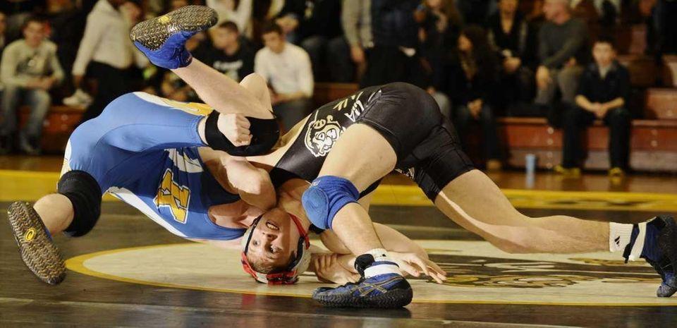 St. Anthony's Grant Greene, right, wrestles Kellenberg's Zach