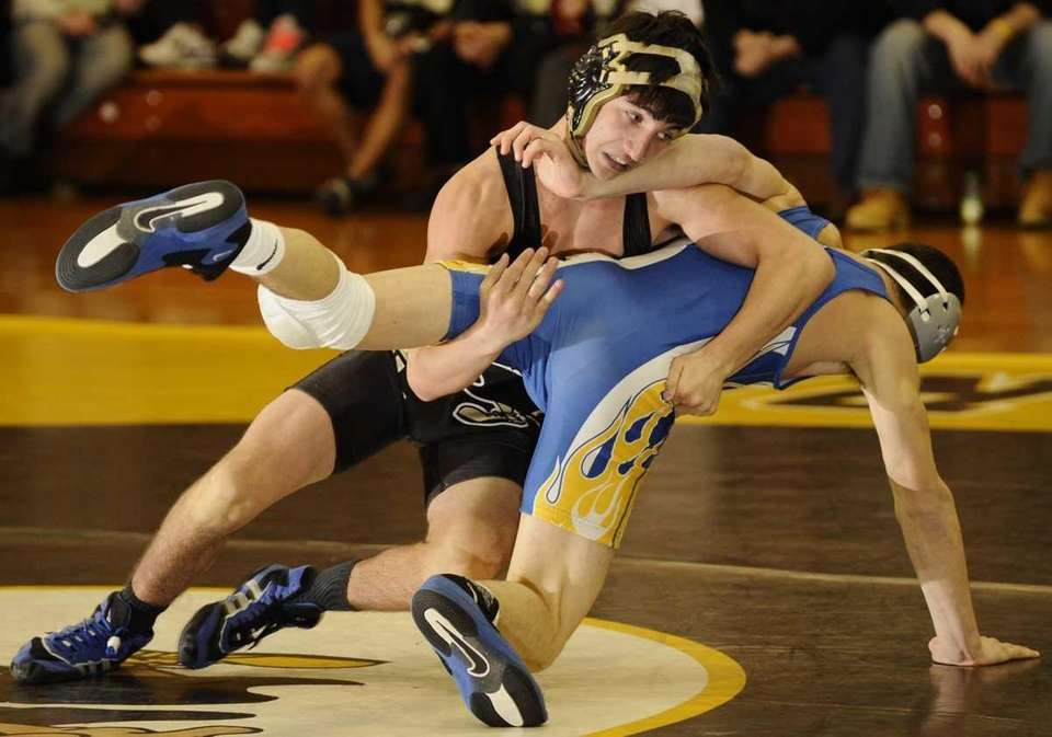 St. Anthony's Tom Penza, top, grapples for position