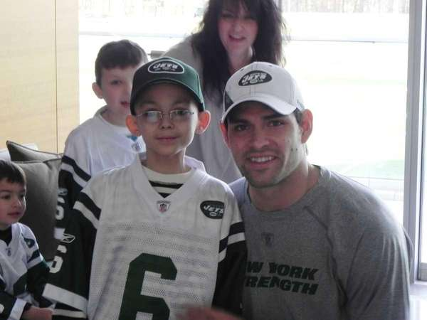 Aiden Binkley, photographed with Mark Sanchez Jets quarterback.