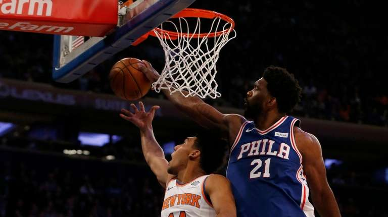 Joel Embiid #21 of the Philadelphia 76ers blocks