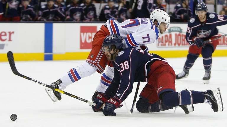 Rangers' Tony DeAngelo, top, collides with Columbus Blue