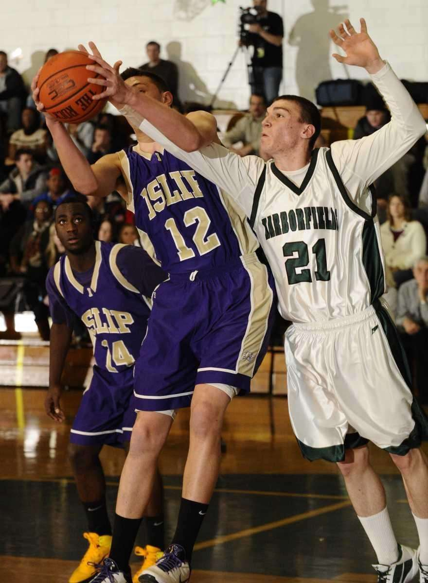 Harborfields' Joseph Savaglio and Islip's Tighe Oberg battle