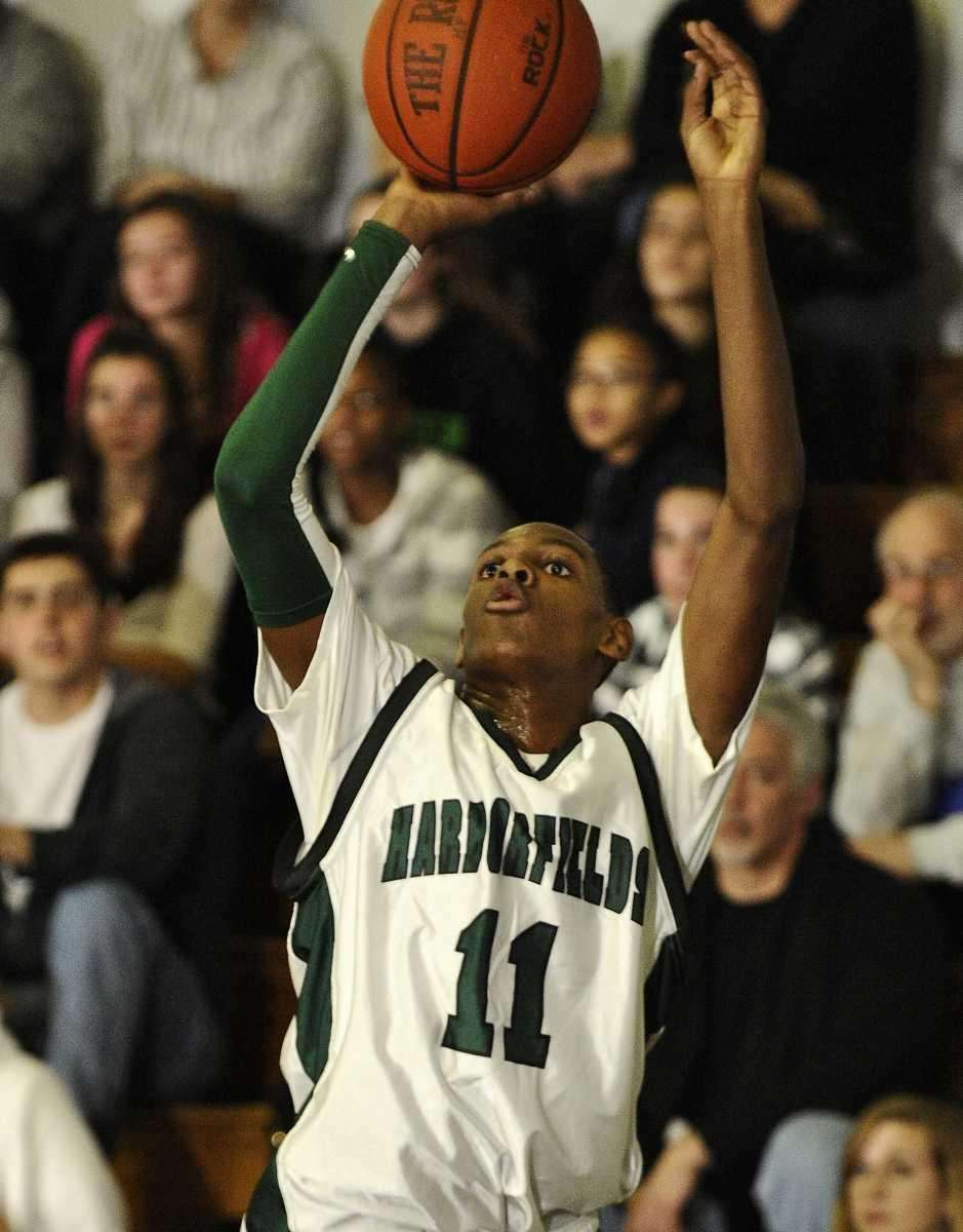 Harborfields' Matt McLeod shoots a 3-pointer against Islip