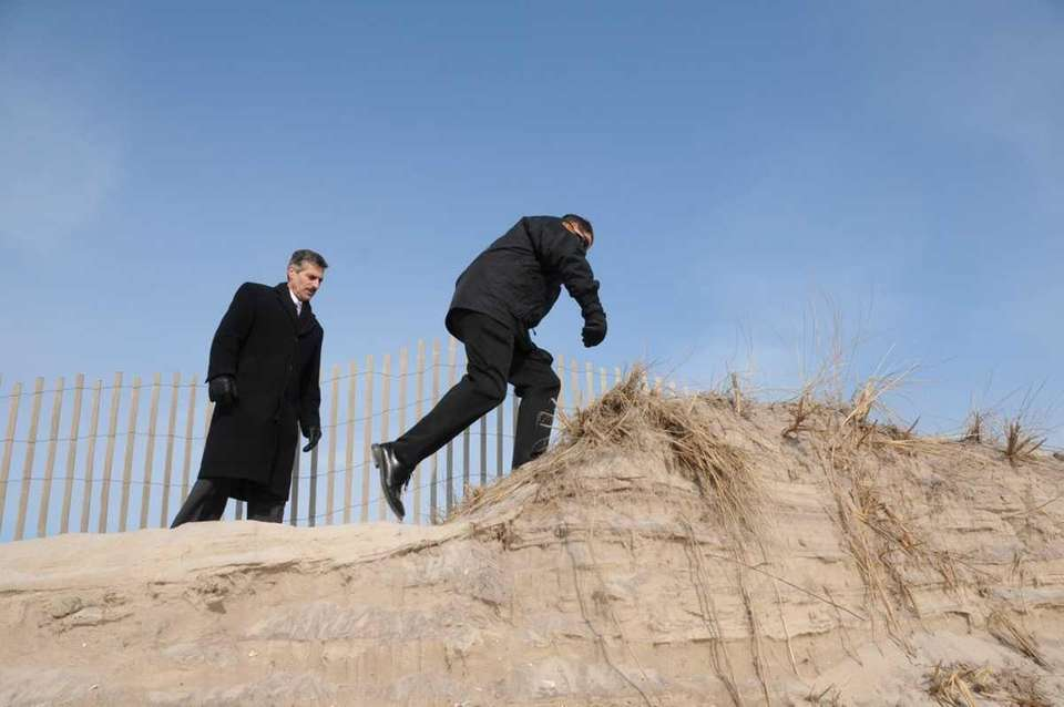 Suffolk County Executive, Steve Levy, surveys beach erosion