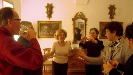 Guests have a toast in the apartment of