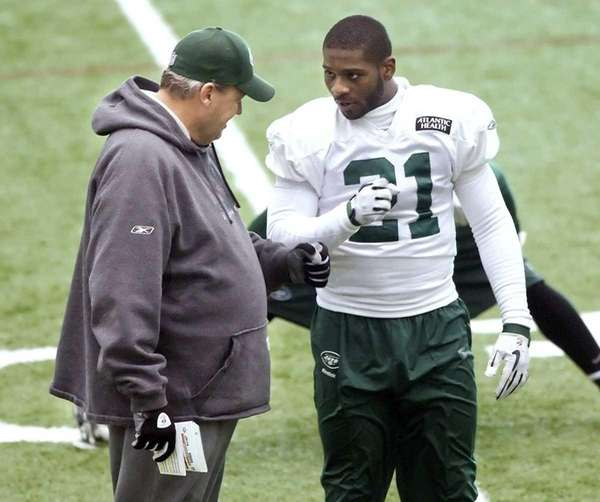 Jets coach Rex Ryan talks with running back