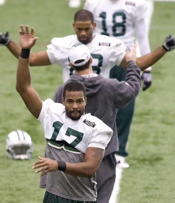 Jets receiver Braylon Edwards stretches during practice in