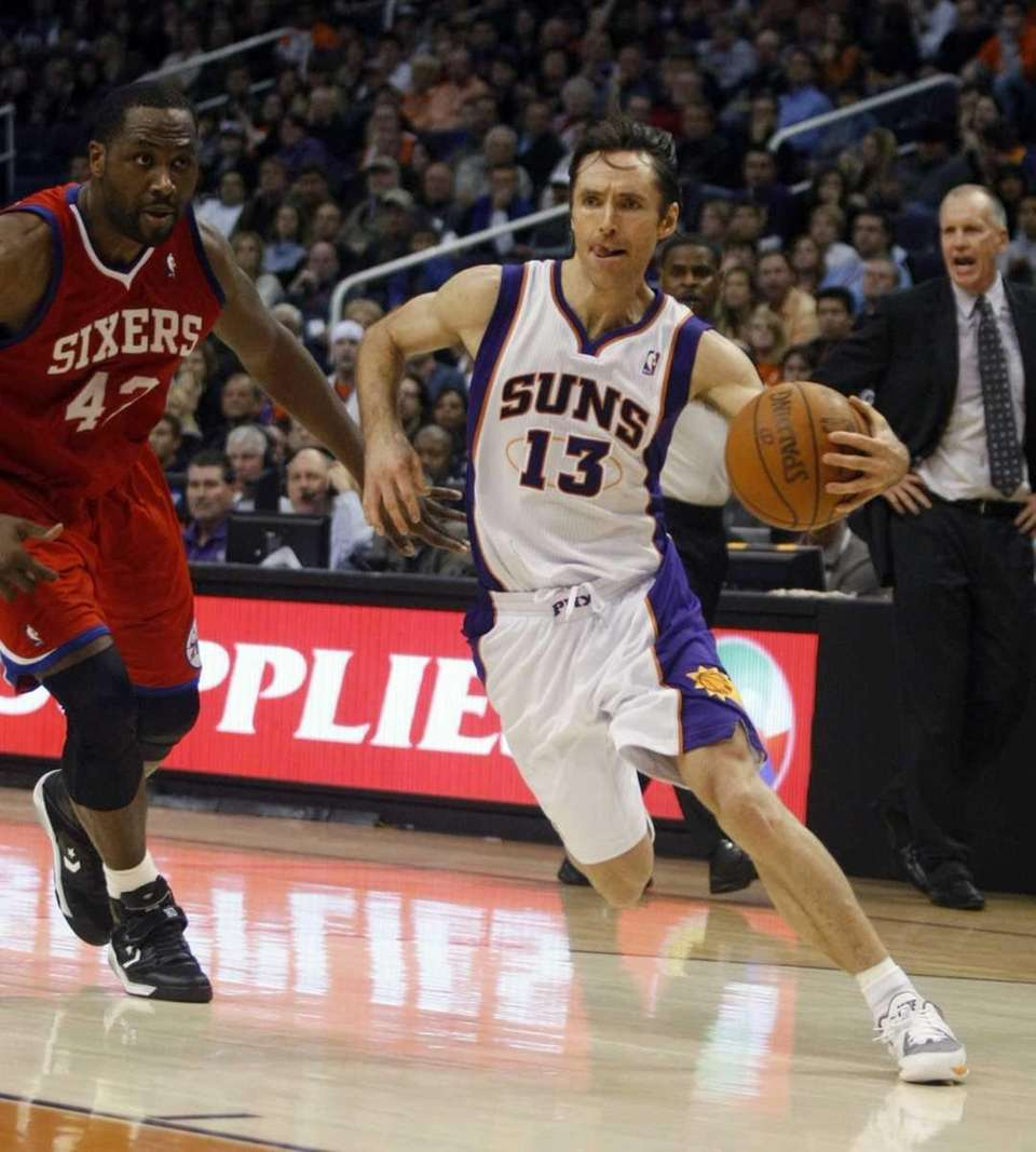 Suns guard Steve Nash, right, drives past 76ers