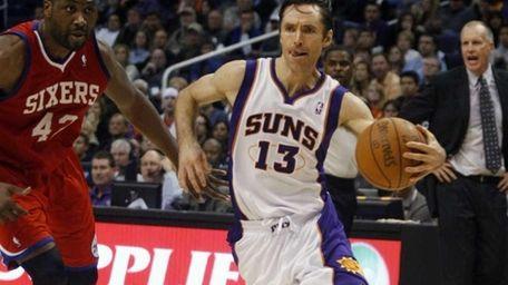 Suns guard Steve Nash, right, drives past 76ers