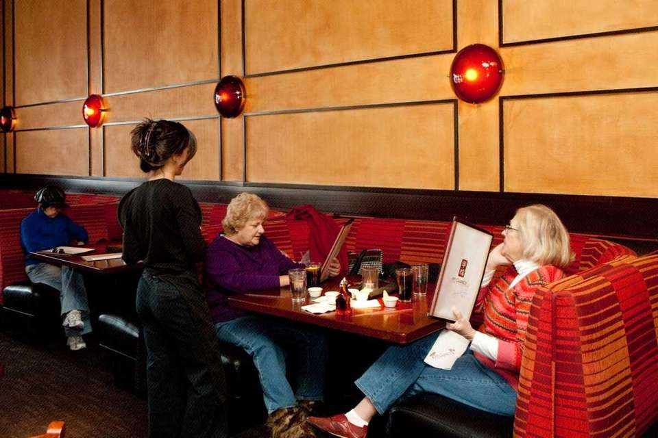 A waitress takes customers' orders at P.F. Chang's