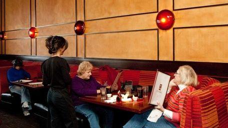 A waitress takes customers' orders at P.F. Chang's