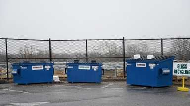 Glass recycling bins on the south parking lot