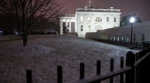 Snow falls on the White House as a