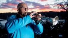 Stanley Wertheimer, 86, plays taps from his hill