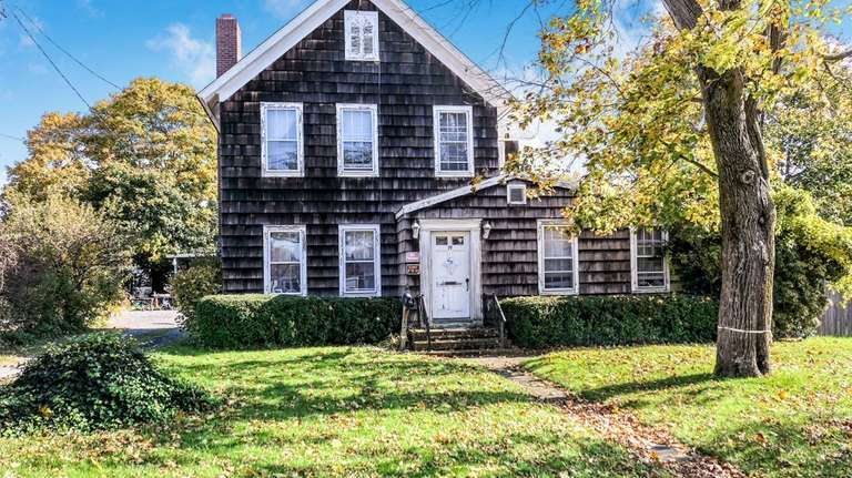 This Bellport property, including two houses and a