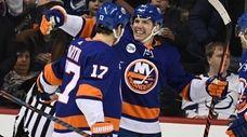Islanders center Casey Cizikas, center, celebrates his goal
