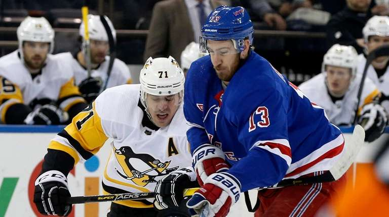 Kevin Hayes of the New York Rangers battles