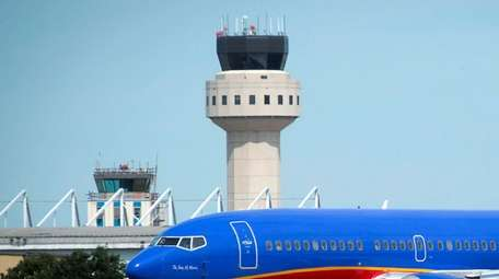 A Southwest plane prepares to take off with