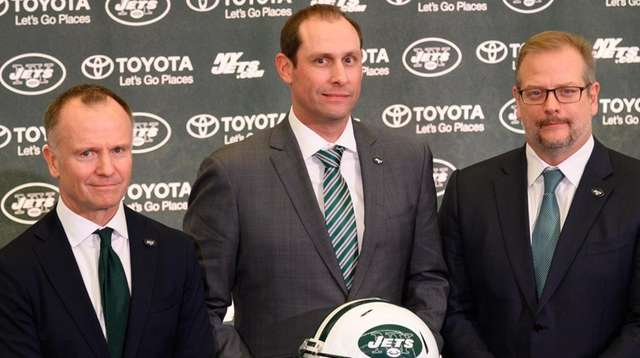 From left, Jets owner Christopher Johnson, new head