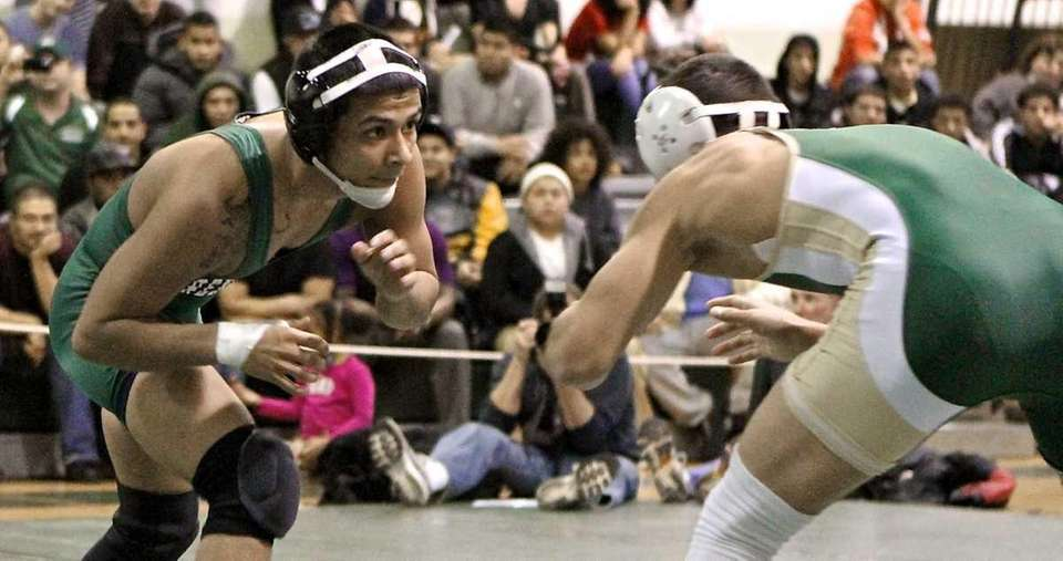 Brentwood's Alex Gomez, left, moves in on Longwood's