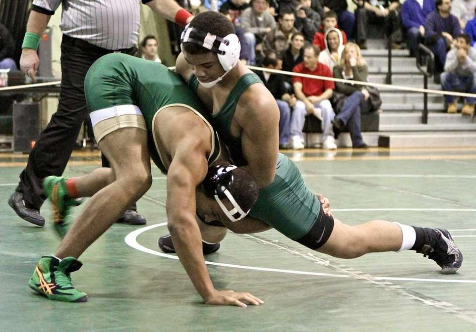 Brentwood's Jared Hudson takes Longwood's Anthony Bulluck to